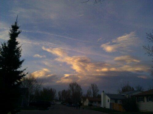 wispy orange sunset clouds