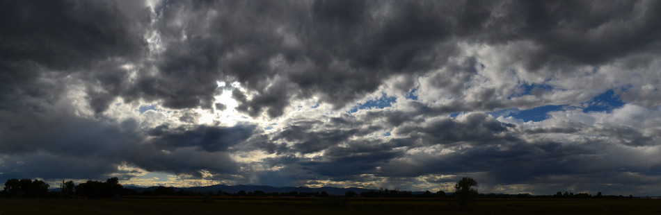 Panoramic Afternoon Stormy Clouds with Crepuscular Rays