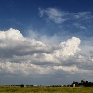 thunderstorm-forming-over-distant-weld-county-colorado-2012-06-07-featured