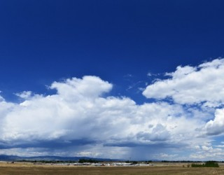 distant-thunderstorm-sunny-day-2012-07-25-featured