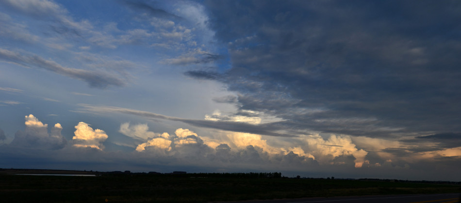 Distant Cumulus Clouds at Sunset Panoramic