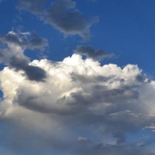 vibrant-blue-sky-with-sunlit-cumulus-cloud-2013-06-26-featured